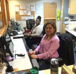 Irma Wilson and Dara Chiem check-in patients at Eastgate Public Health-Family Health and Family Planning Programs