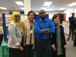 Denise Sherify from the Environmental Health division, and Robin Pfohman, manager of the Vulnerable Populations Action Team, at the Somali Health Fair with Somali Health Board members Fardous Guled and Mohamed Ali.