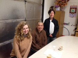 Hannah Van Den Brandt and Robin Pfohman meeting with a leader at Fa Sheng Temple.